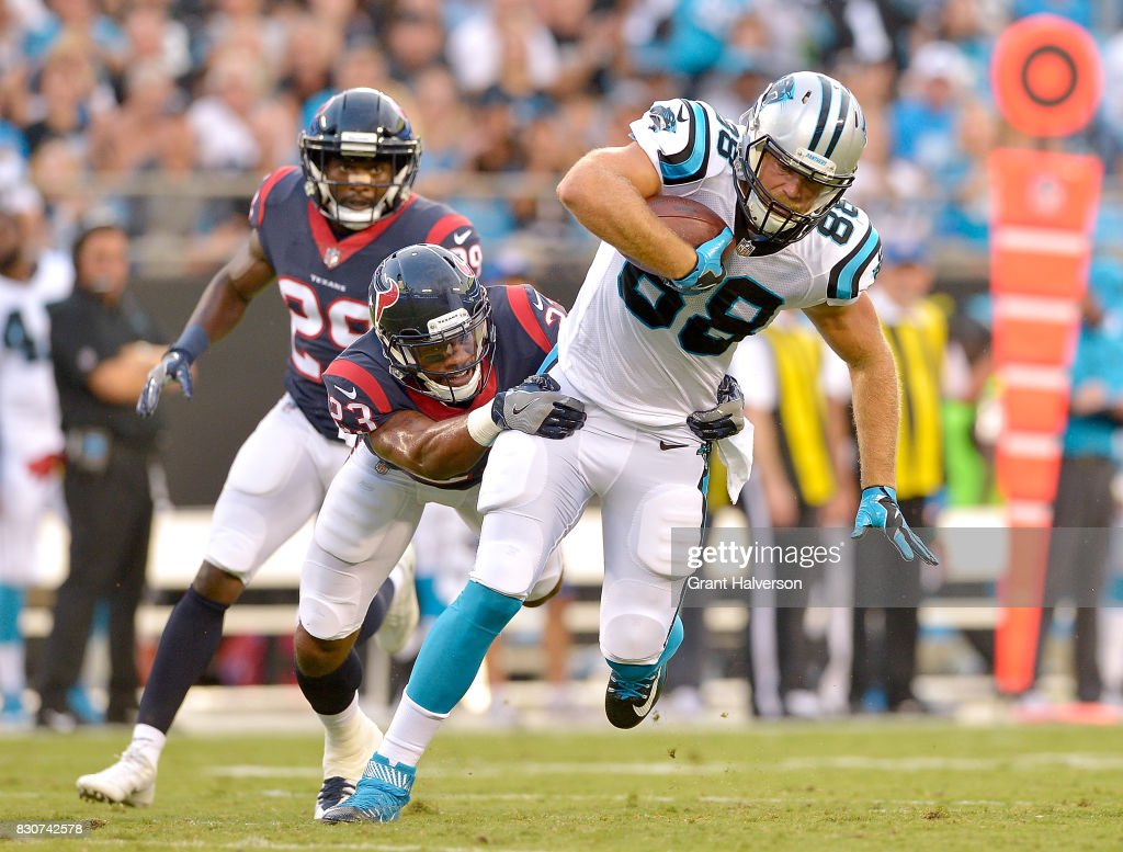 Greg Olsen #88 of the Carolina Panthers makes a catch against Kurtis Drummond #23 of the Houston Texans during their game at Bank of America Stadium on August 9, 2017 in Charlotte, North Carolina.