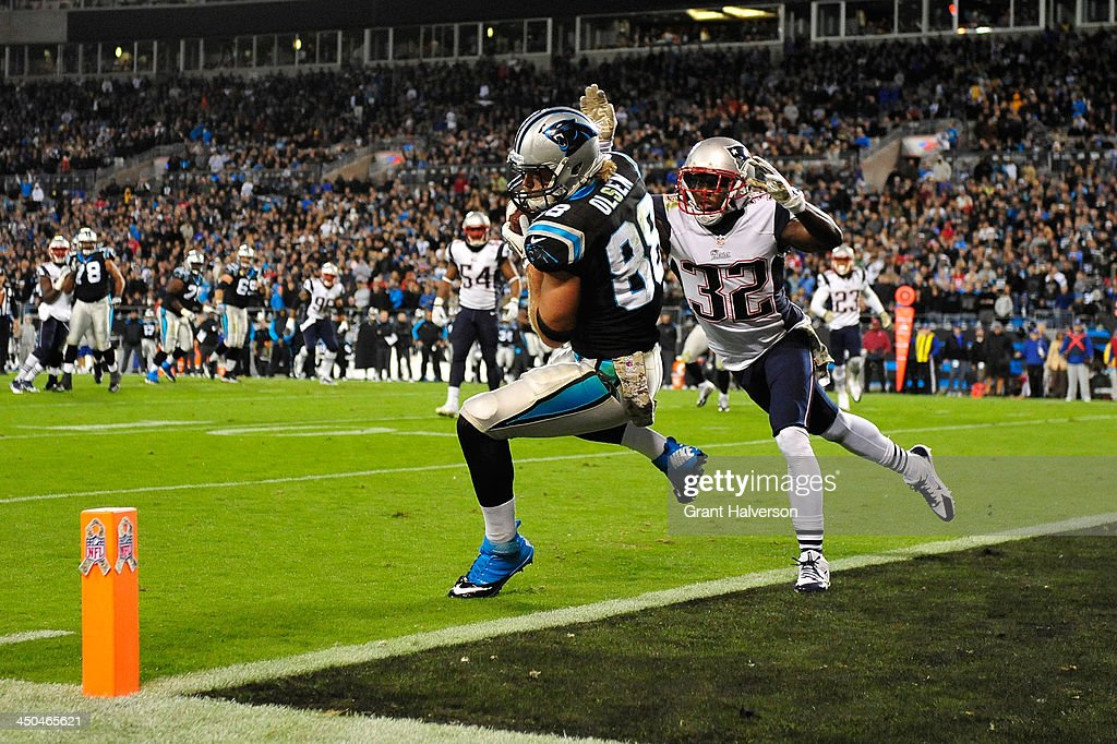 <a gi-track='captionPersonalityLinkClicked' href=/galleries/search?phrase=Greg+Olsen&family=editorial&specificpeople=2166920 ng-click='$event.stopPropagation()'>Greg Olsen</a> #88 of the Carolina Panthers makes a touchdown catch as <a gi-track='captionPersonalityLinkClicked' href=/galleries/search?phrase=Devin+McCourty&family=editorial&specificpeople=4510365 ng-click='$event.stopPropagation()'>Devin McCourty</a> #32 of the New England Patriots defends during play at Bank of America Stadium on November 18, 2013 in Charlotte, North Carolina. The Panthers won 24-20.