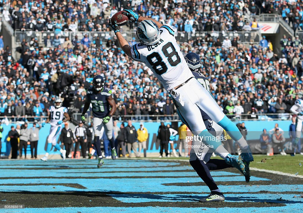 Greg Olsen of the Carolina Panthers makes a touchdown reception during the second quarter of the NFC Divisional Playoff Game against the Seattle...
