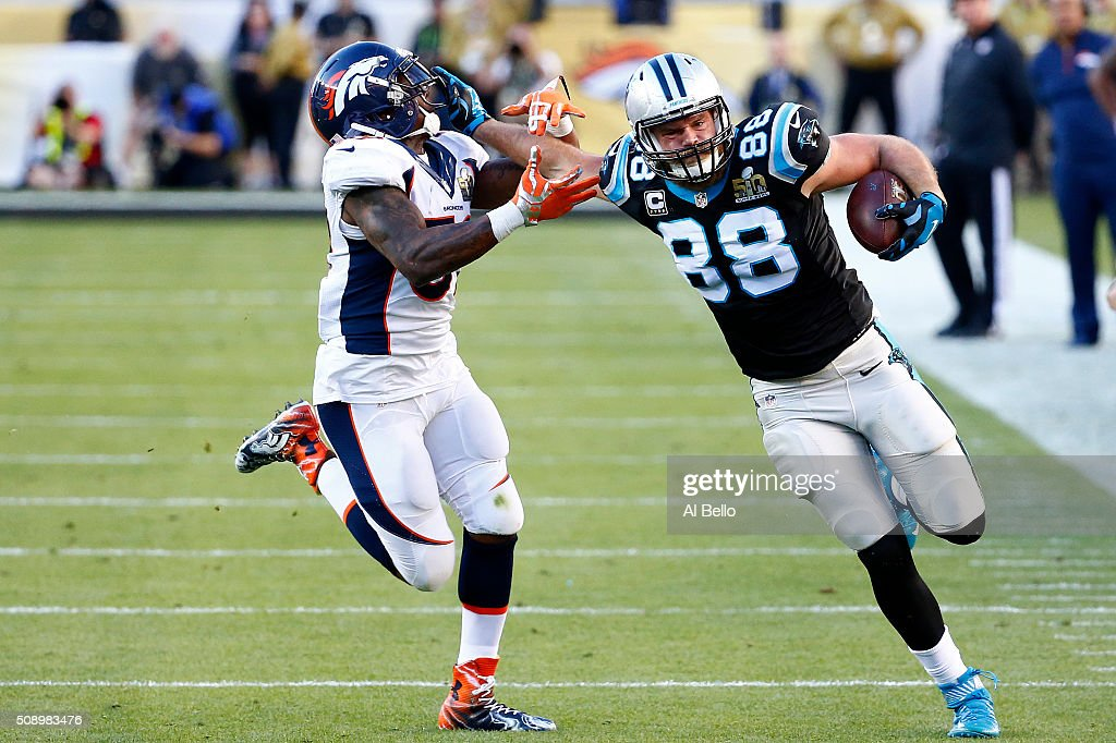 <a gi-track='captionPersonalityLinkClicked' href=/galleries/search?phrase=Greg+Olsen&family=editorial&specificpeople=2166920 ng-click='$event.stopPropagation()'>Greg Olsen</a> #88 of the Carolina Panthers runs after a catch against <a gi-track='captionPersonalityLinkClicked' href=/galleries/search?phrase=Danny+Trevathan&family=editorial&specificpeople=6475347 ng-click='$event.stopPropagation()'>Danny Trevathan</a> #59 of the Denver Broncos in the first half during Super Bowl 50 at Levi's Stadium on February 7, 2016 in Santa Clara, California.