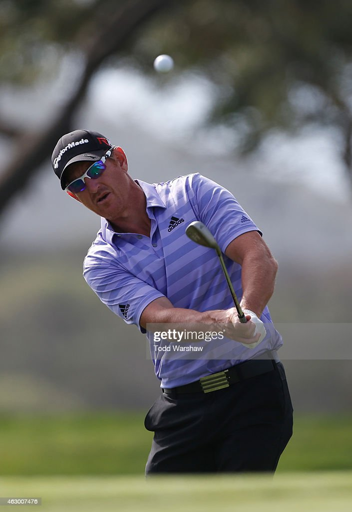 Greg Owen of England chips onto the green on the 17th hole during the final round of the Farmers Insurance Open at Torrey Pines South on February 8, 2015 in La Jolla, California.