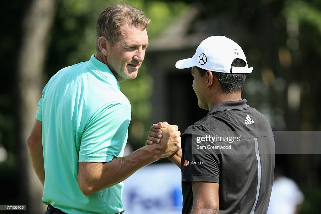 Greg Owen of England congratulates winner Fabian Gomez of Argentina after the final round of the FedEx St Jude Classic at TPC Southwind on June 14...