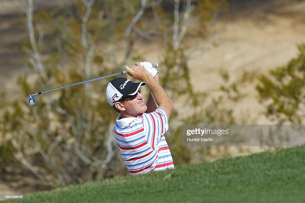 <a gi-track='captionPersonalityLinkClicked' href=/galleries/search?phrase=Greg+Owen&family=editorial&specificpeople=214705 ng-click='$event.stopPropagation()'>Greg Owen</a> of England hits his second shot on the sixth hole during the first round of the Waste Management Phoenix Open at TPC Scottsdale on January 31, 2013 in Scottsdale, Arizona.