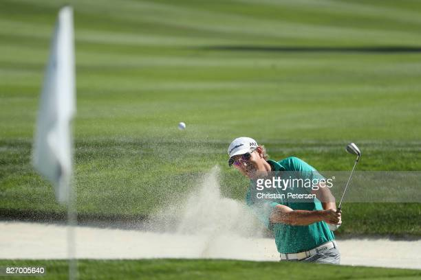 Greg Owen of England plays his shot out of the bunker on the second hole during the final round of the Barracuda Championship at Montreux Country...