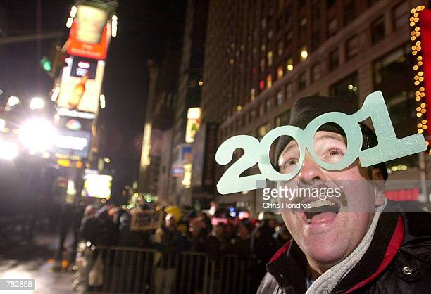 Greg Packer of Huntington NY smiles December 31 2000 while waiting for the ball to drop in Times Square in New York Undaunted by cold temperatures...