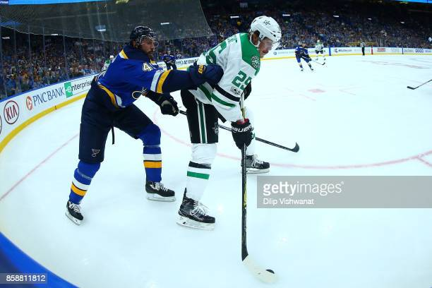 Greg Pateryn of the Dallas Stars controls the puck against Robert Bortuzzo of the St Louis Blues in the second period at the Scottrade Center on...