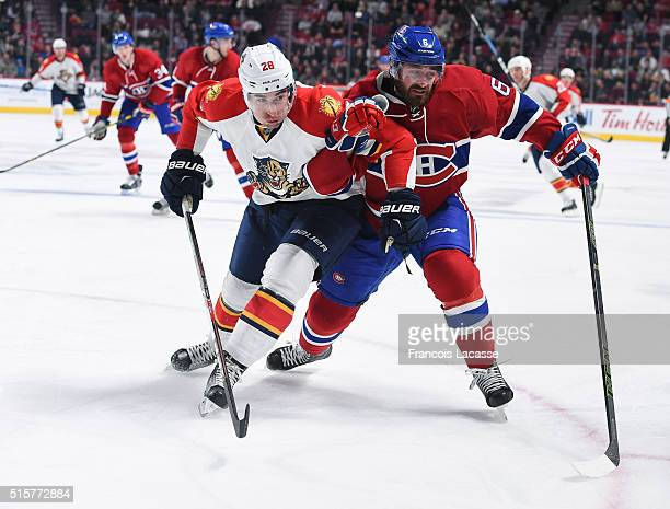 Greg Pateryn of the Montreal Canadiens and Garrett Wilson of the Florida Panthers battle for position in the NHL game at the Bell Centre on March 15...
