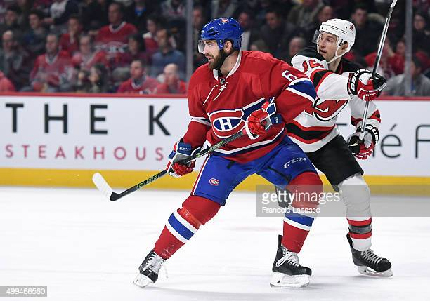 Greg Pateryn of the Montreal Canadiens and Travis Zajac of the New Jersey Devils battle for position in the NHL game at the Bell Centre on November...
