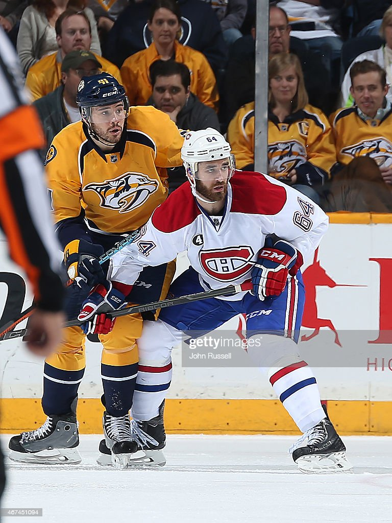 Greg Pateryn #64 of the Montreal Canadiens battles against Taylor Beck #41 of the Nashville Predators during an NHL game at Bridgestone Arena on March 24, 2015 in Nashville, Tennessee.