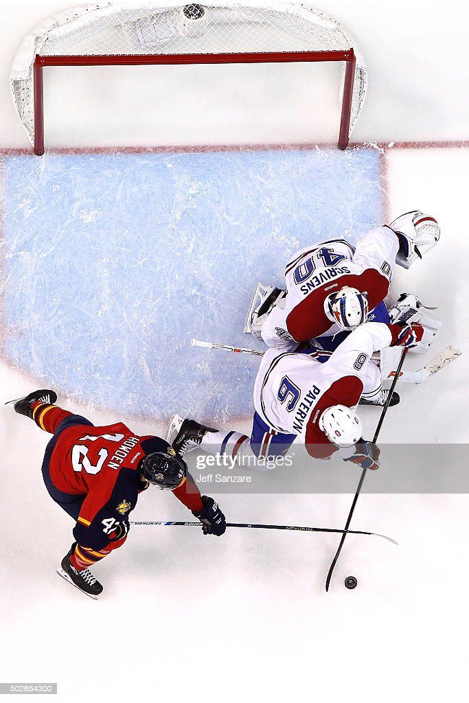 Greg Pateryn #6 of the Montreal Canadiens crosses sticks with Jimmy Hayes #12 of the Florida Panthers at the BB&T Center on December 29, 2015 in Sunrise, Florida.