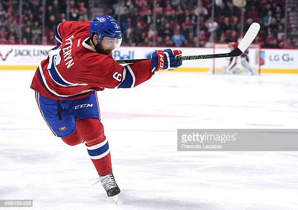 Greg Pateryn of the Montreal Canadiens fires a slap shot against the New Jersey Devils in the NHL game at the Bell Centre on November 28 2015 in...