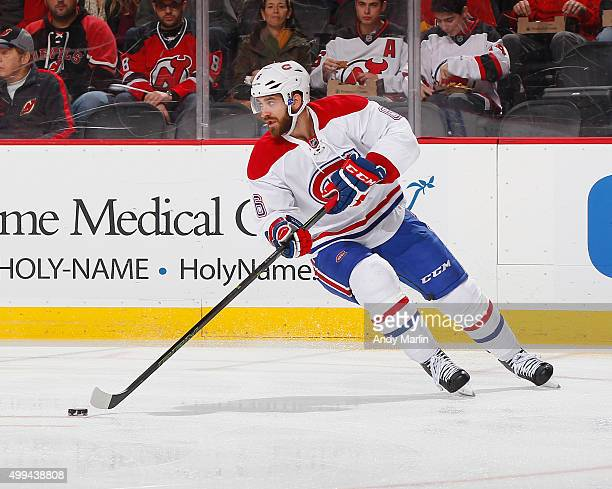 Greg Pateryn of the Montreal Canadiens plays the puck during the game against the New Jersey Devils at the Prudential Center on November 27 2015 in...