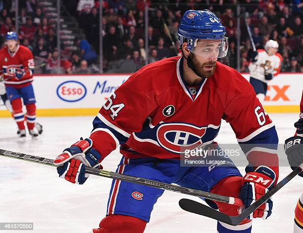 Greg Pateryn of the Montreal Canadiens skates for the puck against the Florida Panthers in the NHL game at the Bell Centre on February 19 2015 in...