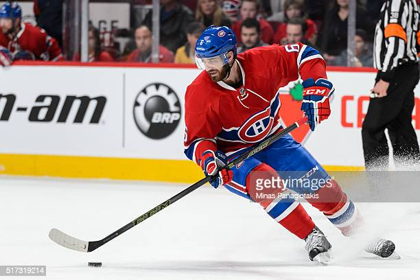 Greg Pateryn of the Montreal Canadiens skates the puck during the NHL game against the Calgary Flames at the Bell Centre on March 20 2016 in Montreal...
