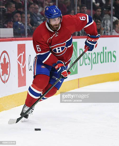 Greg Pateryn of the Montreal Canadiens skates with the puck againsf the Vancouver Canucks in the NHL game at the Bell Centre on November 16 2015 in...