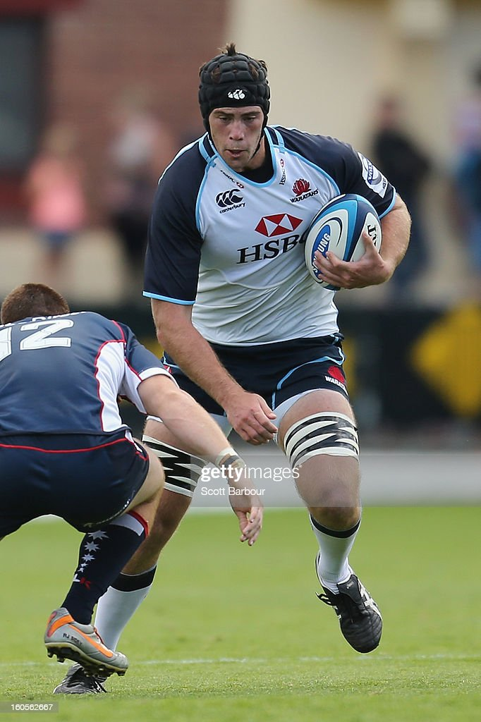 Greg Peterson of the Waratahs is tackled during the Super Rugby trial match between the Waratahs and the Rebels at North Hobart Stadium on February 2, 2013 in Hobart, Australia.