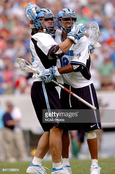 Greg Peyser and Kyle Harrison of Johns Hopkins give each other a hug the final seconds of the Division I Men's Lacrosse Championship help at Lincoln...