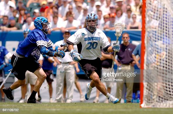Greg Peyser of Johns Hopkins drives past a Duke defender during the Division I Men's Lacrosse Championship help at Lincoln Financial Field in...