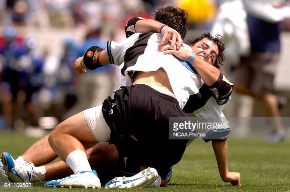 Greg Peyser of Johns Hopkins hugs a teammate following the Division I Men's Lacrosse Championship help at Lincoln Financial Field in Philadelphia PA...