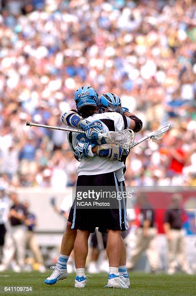Greg Peyser of Johns Hopkins recevies a hug from teammate Jake Byrne after scoring one of his two goals during the Division I Men's Lacrosse...