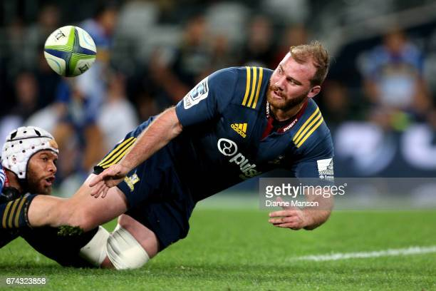 Greg PleasantsTate of the Highlanders offloads the ball while in the tackle of Nizaam Carr of the Stormers during the round 10 Super Rugby match...