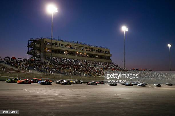 Greg Pursley driver of the Gene Price Motorsports/Star Nursery/Real Water Ford and David Mayhew driver of the Steak Grape/MMI Services Chevrolet lead...