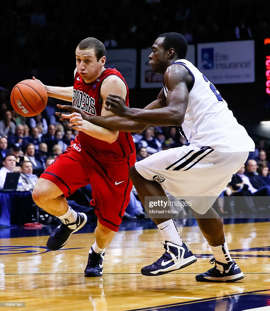 Greg Robbins #22 of the Richmond Spiders dribbles the ball to the hoop as <a gi-track='captionPersonalityLinkClicked' href=/galleries/search?phrase=Khyle+Marshall&family=editorial&specificpeople=7406043 ng-click='$event.stopPropagation()'>Khyle Marshall</a> #23 of the Butler Bulldogs defends at Hinkle Fieldhouse on January 16, 2013 in Indianapolis, Indiana. Butler defeated Richmond 62-47.