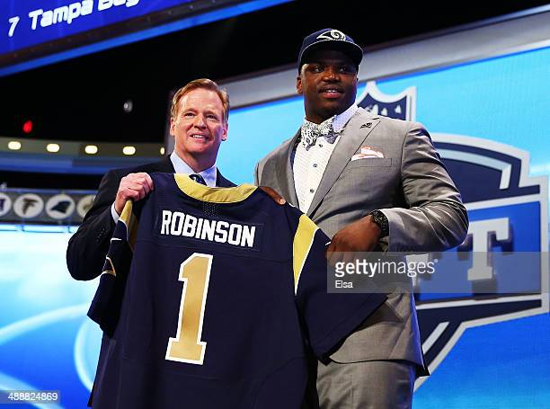 Greg Robinson of the Auburn Tigers poses with NFL Commissioner Roger Goodell after he was picked overall by the during the first round of the 2014...