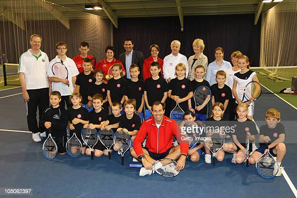 Greg Rusedski and Roger Draper pose and young tennis players pose during the opening of the Stafford Sports College on October 8 2010 in Stafford...