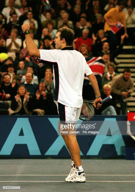 Greg Rusedski celebrates his win over Argentinian Mariano Zabaleta during their AXA Cup tennis match at the London Arena Rusedski claimed a semifinal...