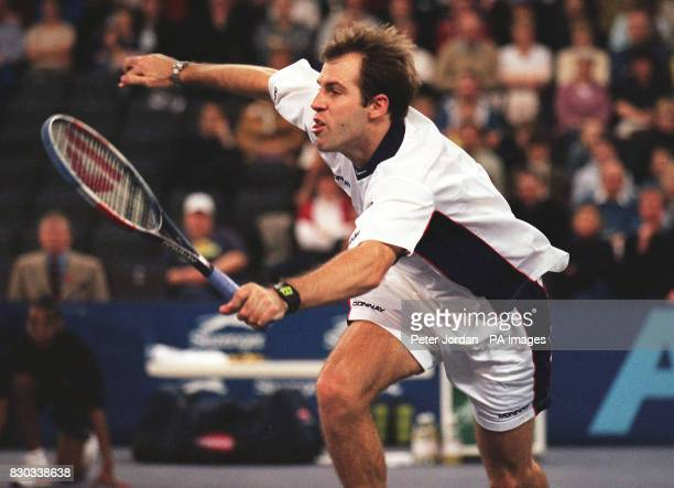 Greg Rusedski in action against Argentinian Mariano Zabaleta during their AXA Cup tennis match at the London Arena Rusedski claimed a semifinal place...