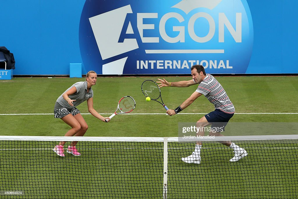Greg Rusedski of Great Britain (R) and Petra Kvitova of the Czech Republic (L) play a shot during the Rally for Bally exhibtion match against Colin Fleming of Great Britain and Agnieszka Radwanska of Poland on day two of the Aegon International at Devonshire Park on June 15, 2014 in Eastbourne, England.