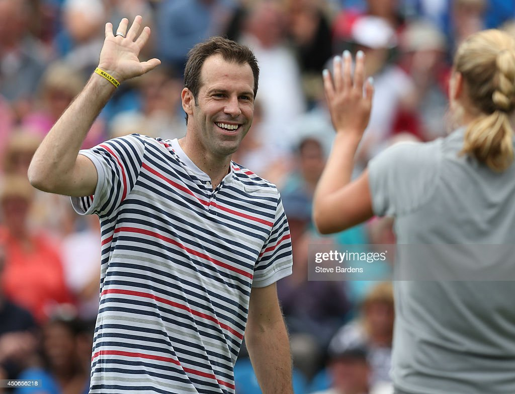 <a gi-track='captionPersonalityLinkClicked' href=/galleries/search?phrase=Greg+Rusedski&family=editorial&specificpeople=201807 ng-click='$event.stopPropagation()'>Greg Rusedski</a> of Great Britain celebrates a point with Petra Kvitova of the Czech Republic during the Rally for Bally mixed doubles charity match on day two of the Aegon International at Devonshire Park on June 15, 2014 in Eastbourne, England.