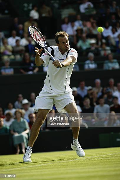 Greg Rusedski of Great Britain in action during his match against Alexander Waske of Germany during the opening day of the Wimbledon Lawn Tennis...