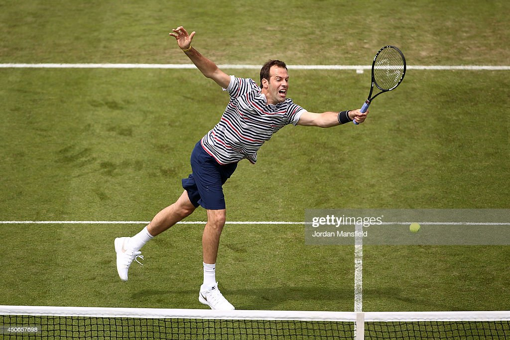 Greg Rusedski of Great Britain plays a forehand during the Rally for Bally exhibtion match against Colin Fleming of Great Britain and Agnieszka Radwanska of Poland on day two of the Aegon International at Devonshire Park on June 15, 2014 in Eastbourne, England.