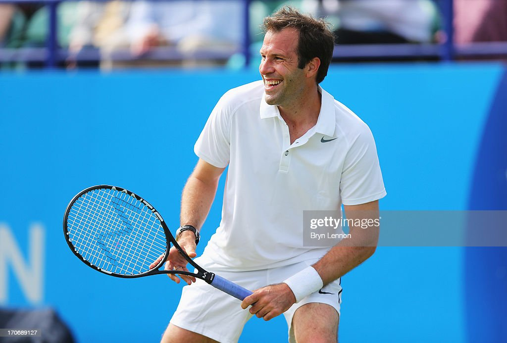 Greg Rusedski of Great Britain smiles in his men's singles exhibition legends match against Mark Philippoussis of Australia during day two of the AEGON International tennis tournament at Devonshire Park on June 16, 2013 in Eastbourne, England.