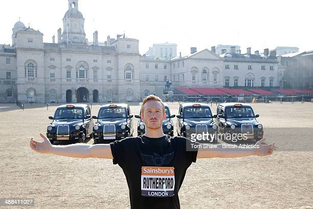 Greg Rutherford of Great Britain and Olympic Champion poses in front of five London Taxis representing the approximate distance of the long jump...