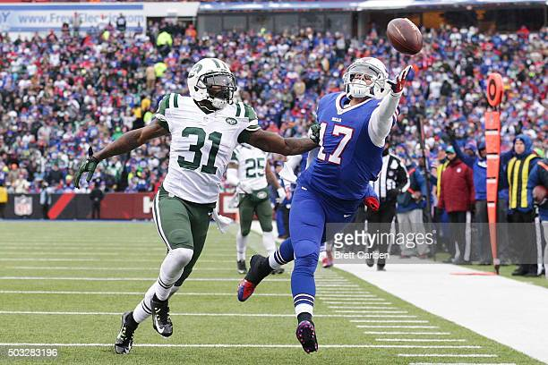 Greg Salas of the Buffalo Bills can't make the catch as Antonio Cromartie of the New York Jets defends during the first half at Ralph Wilson Stadium...