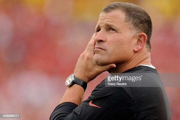 Greg Schiano head coach of the Tampa Bay Buccaneers watches the action during a game against the San Francisco 49ers at Raymond James Stadium on...
