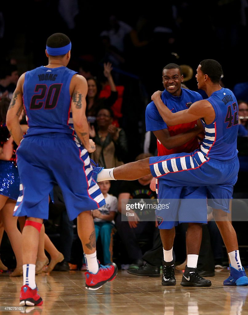 Greg Sequele and Brandon Young of the DePaul Blue Demons celebrate the win over the Georgetown Hoyas during the first round of the Big East...