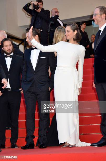 Greg Shapiro actor Jeremy Renner Marion Cotillard and director James Gray attend 'The Immigrant' Premiere during the 66th Annual Cannes Film Festival...