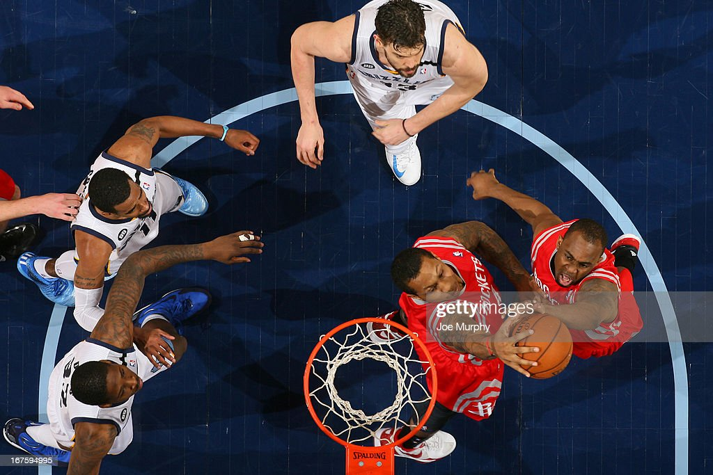 Greg Smith #4 and James Anderson #5 of the Houston Rockets go up for a rebound against the Memphis Grizzlies on March 29, 2013 at FedExForum in Memphis, Tennessee.