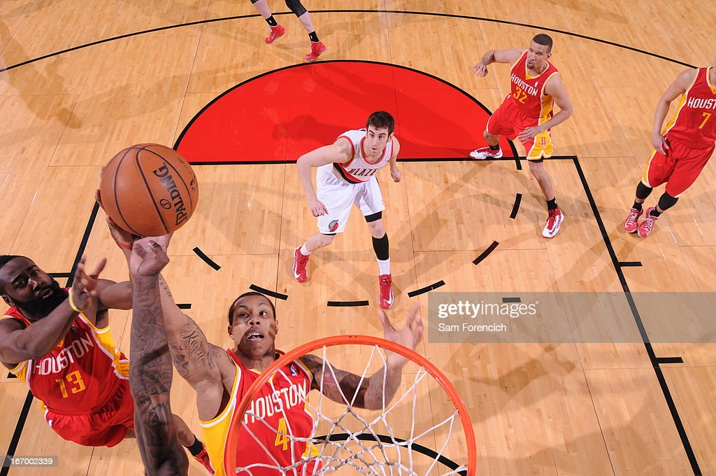 Greg Smith #4 and <a gi-track='captionPersonalityLinkClicked' href=/galleries/search?phrase=James+Harden&family=editorial&specificpeople=4215938 ng-click='$event.stopPropagation()'>James Harden</a> #13 of the Houston Rockets go up for a rebound against the Portland Trail Blazers on April 5, 2013 at the Rose Garden Arena in Portland, Oregon.