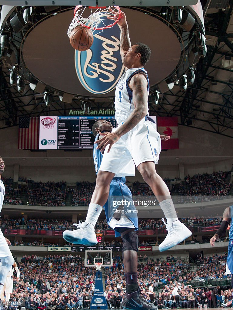 Greg Smith of the Dallas Mavericks goes up for the dunk against the Minnesota Timberwolves on February 2 2015 at the American Airlines Center in...
