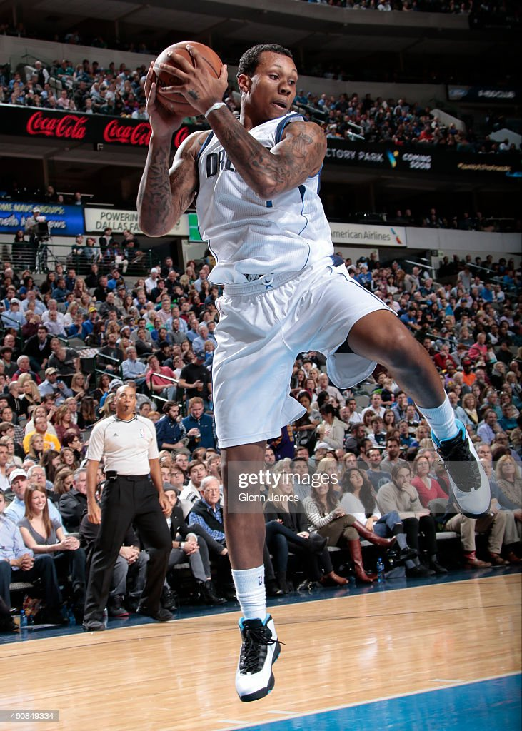 Greg Smith of the Dallas Mavericks grabs a rebound against the Los Angeles Lakers on December 26 2014 at the American Airlines Center in Dallas Texas...