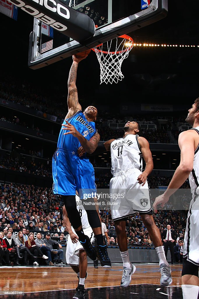 Greg Smith of the Dallas Mavericks shoots the ball against the Brooklyn Nets during the game on January 5 2015 at Barclays Center in Brooklyn New...