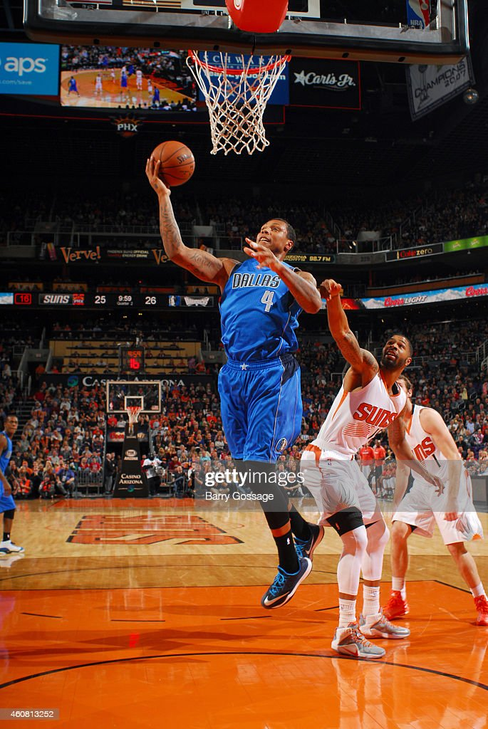 Greg Smith of the Dallas Mavericks shoots the ball against the Phoenix Suns during the game on December 23 2014 at US Airways Center in Phoenix...