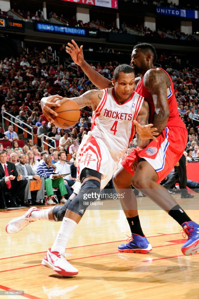 Greg Smith #4 of the Houston Rockets drives against <a gi-track='captionPersonalityLinkClicked' href=/galleries/search?phrase=DeAndre+Jordan&family=editorial&specificpeople=4665718 ng-click='$event.stopPropagation()'>DeAndre Jordan</a> #6 of the Los Angeles Clippers on March 30, 2013 at the Toyota Center in Houston, Texas.