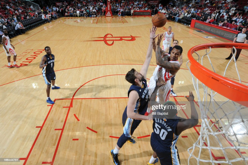 Greg Smith #4 of the Houston Rockets dunks the ball against <a gi-track='captionPersonalityLinkClicked' href=/galleries/search?phrase=Marc+Gasol&family=editorial&specificpeople=661205 ng-click='$event.stopPropagation()'>Marc Gasol</a> #33 of the Memphis Grizzlies on April 12, 2013 at the Toyota Center in Houston, Texas.