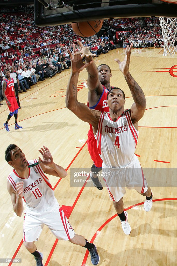 Greg Smith #4 of the Houston Rockets grabs a rebound against the Philadelphia 76ers on December 19, 2012 at the Toyota Center in Houston, Texas.